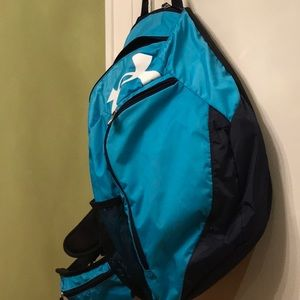 Under Armour turquoise blue side sling backpack.